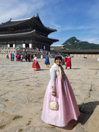 in Hanbok, at Gyeongbokgung Palace